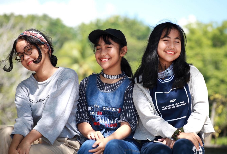 three asian teen age girls happy